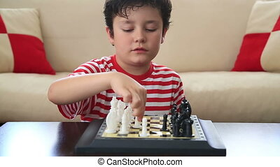 recreation time with chess exercise - Little boy learning...