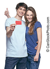 Happy couple with credit card - Happy couple in tshirts...