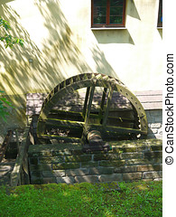 Old wooden mill wheel in brick wall - Old wooden mill wheel...