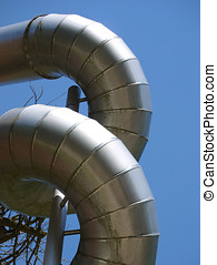 Twisted aluminium construction pipes against blue sky