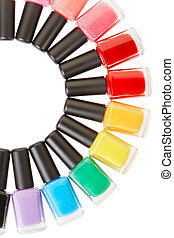 Nail polish colorful bottles circle isolated on white,...