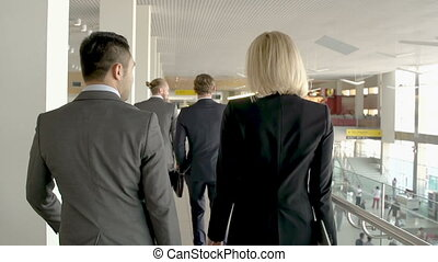 Catching a Plane - Camera following four business people...