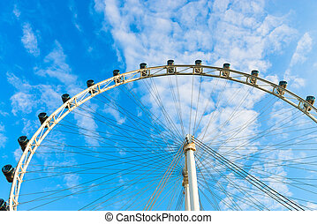 Ferris wheel on blue sky - Big ferris wheel with cabin on...