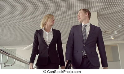 Communication on the Move - Low angle of blond lady and her...