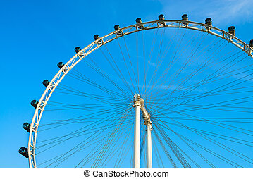 Ferris wheel on blue sky - Big ferris wheel with cabins on...