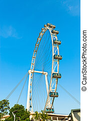 Ferris wheel under blue sky - Big ferris wheel with cabins...