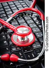 Stethoscope on computer keyboard.