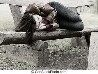 Monochrome image of a woman on a park bench - Monochrome...