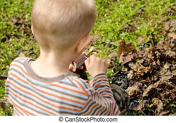 Child striking a match - Child striking a safety match on a...