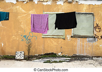 Clothes line in front of an old house under natural light