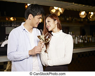 young couple in bar