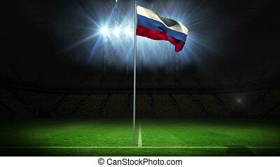 Russia national flag waving on flagpole against football...