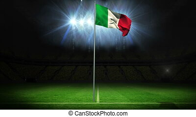 Italy national flag waving on flagpole against football...
