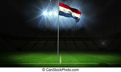 Netherlands national flag waving on flagpole against...