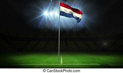 Netherlands national flag waving on flagpole against...