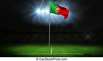 Portugal national flag waving on flagpole against football...