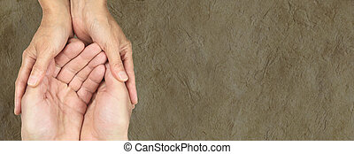 Charity Parchment web banner - Male and female hands in...