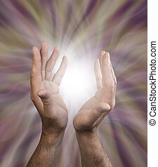 Male healing energy - Male healing hands outstretched with...