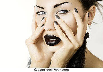 Beautiful girl with black lipstick matte black manicure and...