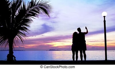 Silhouette couple Make Photo against Sunset - Silhouette...