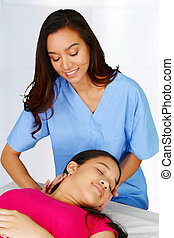 Chiropractor - Female chiropractor working at her office...