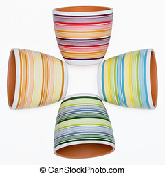 Four flower pot in bright colored stripes lying on its side...