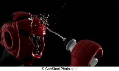 Tough boxer pouring water over himself in slow motion