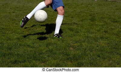 Football player kicking the ball on