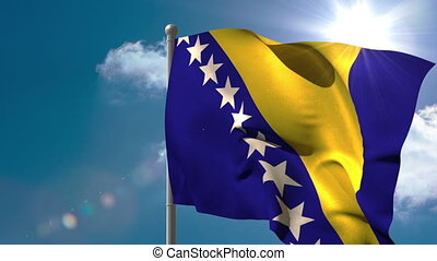 Bosnia national flag waving on flagpole on blue sky...