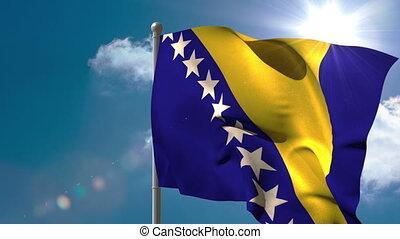 Bosnia national flag waving on flagpole on blue sky...