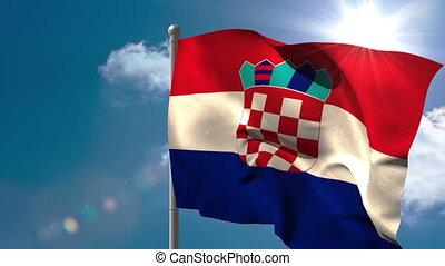Croatia national flag waving on flagpole on blue sky...