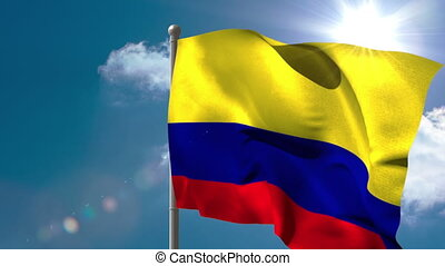 Colombia national flag waving on flagpole on blue sky...