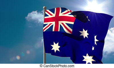 Australia national flag waving on flagpole on blue sky...