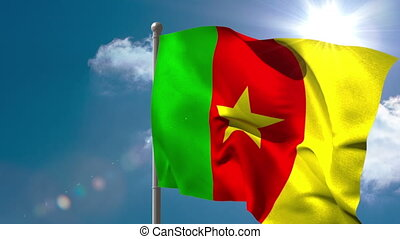 Cameroon national flag waving on flagpole on blue sky...