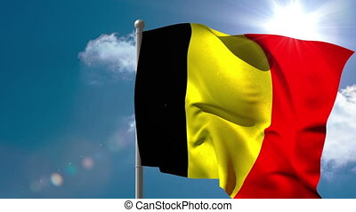 Belgium national flag waving on flagpole on blue sky...