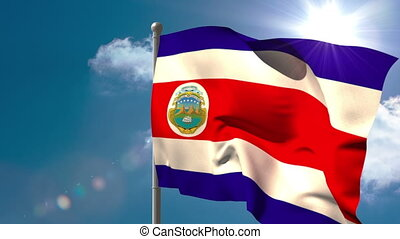 Costa rica national flag waving on flagpole on blue sky...