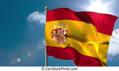 Spain national flag waving on flagpole on blue sky...