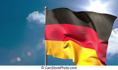 Germany national flag waving on flagpole on blue sky...