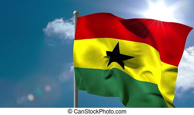Ghana national flag waving on flagpole on blue sky...