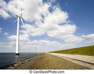 Wind turbines in the IJsselmeer near Lelystad in the...