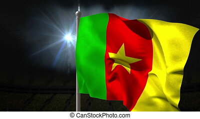 Cameroon national flag waving on flagpole on black...