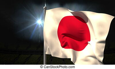 Japan national flag waving on flagpole on black background...
