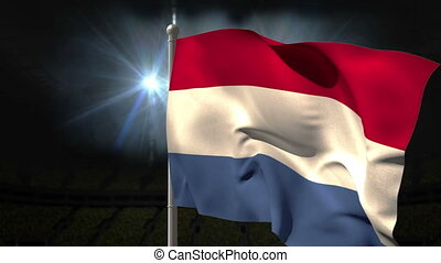 Netherlands national flag waving on flagpole on black...