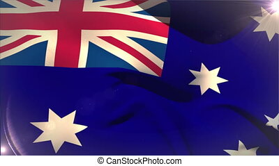 Large australia national flag waving with lens flare