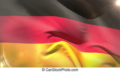 Large german national flag waving with lens flare