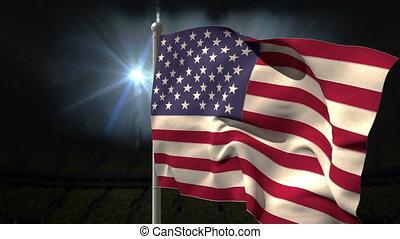 USA national flag waving on flagpole on black background...