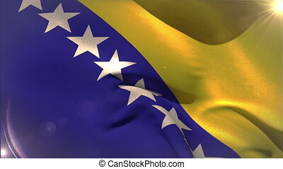 Large bosnia national flag waving with lens flare