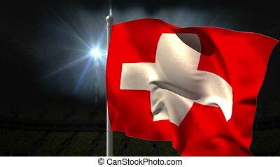 Swiss national flag waving on flagpole on black background...