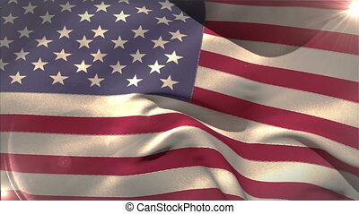 Large usa national flag waving with lens flare