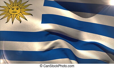 Large uruguay national flag waving with lens flare